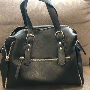 Black Jessica handbag with gold colour zippers